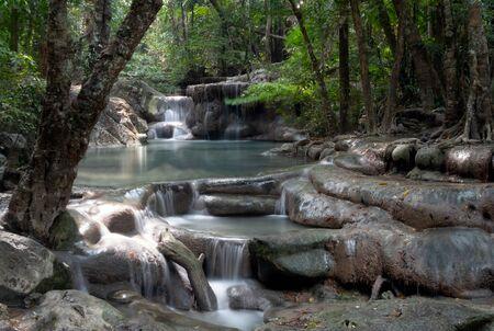 Waterfall in national park in jungle, long exposure, in Kanchanaburi, Thailand