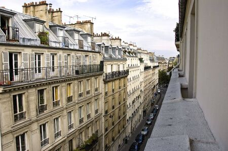 Row of apartment buildings and street in Paris viewed from a balcony photo
