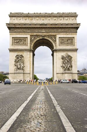 stone arches: Street level view of Arc de Triomphe from Avenue des Champs-Elysees Stock Photo