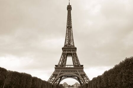 ironwork: Eiffel Tower sepia toned image with overcast sky taken from Champ-de-Mars