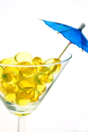 Concept of omega-3 pills taken as a tropical drink photo