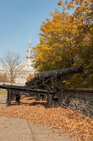 Le Petit Seminaire in Old Quebec City flanked by British cannons