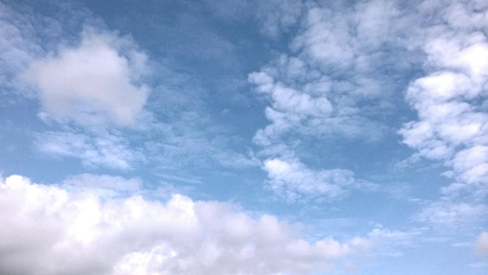 bright: Blue sky with fluffy white clouds