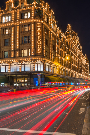 harrods: LONDON - DECEMBER 21st 2014: View of Harrods with christmas decorations. The store, formerly owned by Mohamed Al-Fayed, then sold to Qatar Holdings is one of the most famous luxury stores in Londo Editorial
