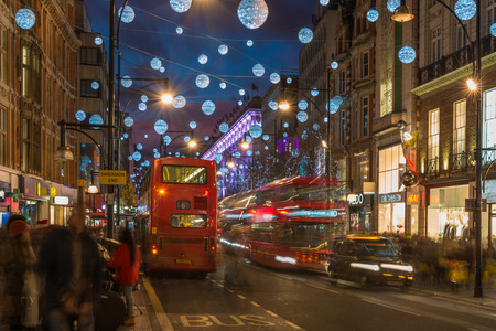 bond street: LONDON - DECEMBER 21st 2014: Christmas lights on Oxford Street, London, UK. The full length of the busiest shopping area in central London is decorated with 1778 glowing white orbs