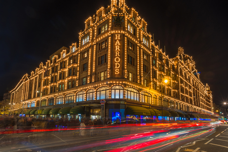 bond street: LONDON - DECEMBER 21st 2014: View of Harrods with christmas decorations. The store, formerly owned by Mohamed Al-Fayed, then sold to Qatar Holdings is one of the most famous luxury stores in London