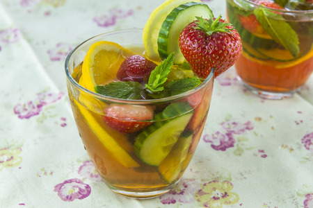 Refreshing PImms cocktail with lemonade Фото со стока