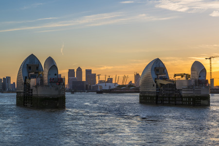 LONDON, UK - JUNE 06, 2015: Themes Barrier and Millennium Dome at dusk, view across river Thames. It was built to house an exhibition celebrating the beginning of the third millennium. It's now a key feature of The O2 Редакционное