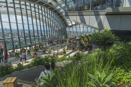 public space: LONDON, UK - JULY 4, 2015: The Sky Garden at 20 Fenchurch Street is a unique public space designed by Rafael Vinoly Architects. It features a stylish restaurant; brasserie and cocktail bar
