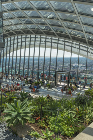 richard: LONDON, UK - JULY 4, 2015: The Sky Garden at 20 Fenchurch Street is a unique public space designed by Rafael Vinoly Architects. It features a stylish restaurant; brasserie and cocktail bar