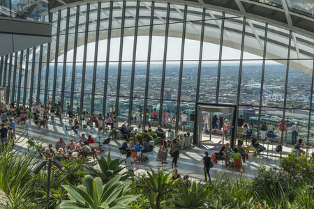 brasserie: LONDON, UK - JULY 4, 2015: The Sky Garden at 20 Fenchurch Street is a unique public space designed by Rafael Vinoly Architects. It features a stylish restaurant; brasserie and cocktail bar