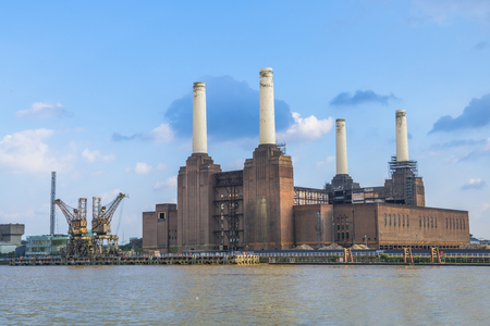 industrial heritage: View of abandoned Battersea power station across river Thames, London, UK