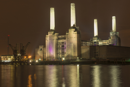 battersea: Night view of abandoned Battersea power station across river Thames, London, UK Stock Photo