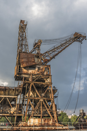 decrepitude: A rusty, derelict crane at the abandoned Battersea power station, London, UK