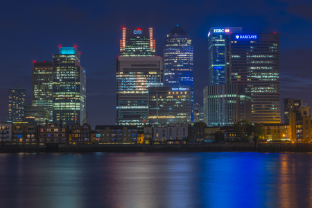 LONDON, UK -AUGUST 22, 2015: Night view of Canary Wharf, a major business district located in London, UK. Its a home to the headquarters of numerous major banks and other professional service firms Editorial