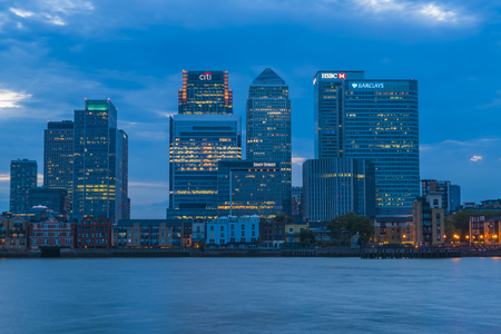 LONDON, UK - AUGUST 22, 2015:Evening view of Canary Wharf, a major business district located in London, UK. It's a home to the headquarters of numerous major banks and other professional service firms