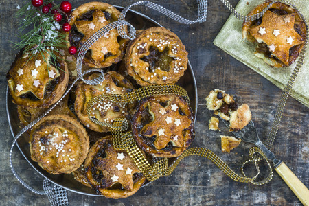 mincemeat: Traditional homemade Christmas mince pies on old rustic wooden table Stock Photo