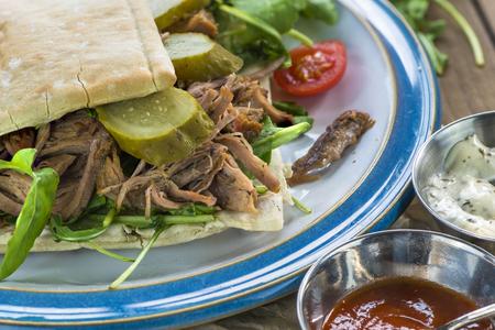 the lamb: Pulled lamb with fresh rocket salad and pitta bread