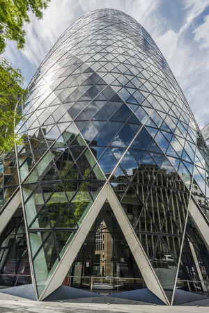 30 st mary axe: LONDON, UK - JUNE 08, 2014: View of Gherkin building 30 St Mary Axe in London. Gherkin is an iconic symbol of London, one of citys most widely recognized examples of modern architecture.