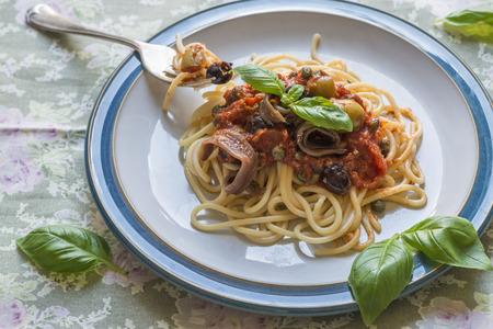 puttanesca: Spaghetti with traditional Italian puttanesca sauce