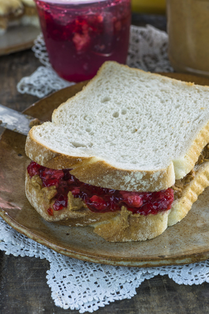 peanut butter and jelly: Peanut butter and jelly sandwich Stock Photo