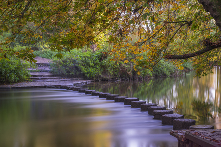 stepping on: Stepping Stones over the river Mole at the foot of Box Hill, Surrey, UK
