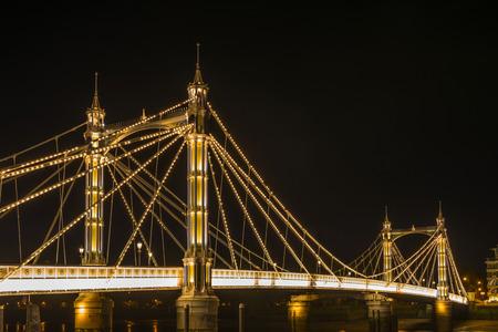 brige: Illuminated Albert bridge in west London at night