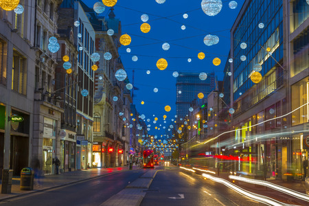 bond street: LONDON - NOVEMBER 21st 2015: Christmas lights on Oxford Street, London, UK. The full length of the busiest shopping area in central London is decorated with 1778 glowing white and golden orbs.