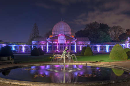 laser lights: LONDON - NOVEMBER 22nd 2015: Glass conservatory in Syon Park, London illuminated by laser lights at night