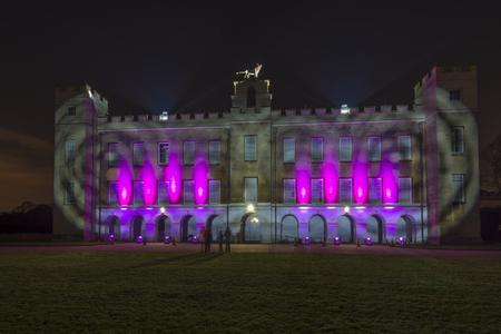 laser lights: LONDON - NOVEMBER 22nd 2015: Syon House illuminated with bright laser lights at night in Syon Park. London UK Editorial