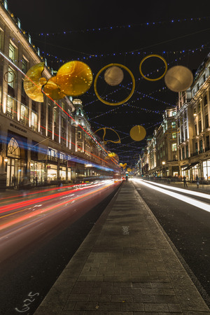 christmas lights display: LONDON - NOVEMBER 26th 2015: This years Regent Street Christmas lights feature shimmering golden sequins, cogs and coils which create a glittering setting for shoppers