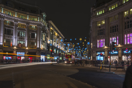regent: LONDON - NOVEMBER 26th 2015: The world-famous Christmas lights in Oxford Street and Regent Street create a glittering setting for shoppers