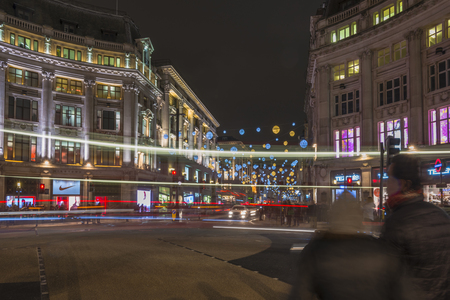 regent: LONDON - NOVEMBER 26th 2015:  The world-famous Christmas lights in Oxford Street and Regent Street create a glittering setting for shoppers Editorial