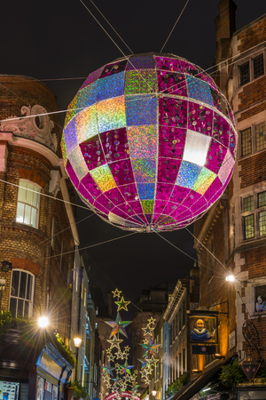 christmas lights display: LONDON - NOVEMBER 26th 2015: Christmas lights on Carnaby Street, London UK. Carnaby Christmas lights feature some of the most unusual Christmas decorations and lights in London. Editorial
