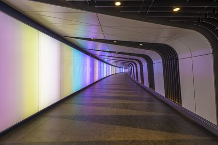 metre: LONDON, UK - DECEMBER 12, 2015: The 90 metre long curved pedestrian tunnel features an LED integrated lightwall and links St Pancras International and Kings Cross St Pancras Underground stations. Editorial