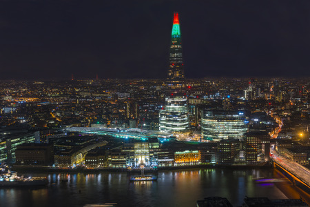 uninterrupted: LONDON, UK - DECEMBER 19, 2015: Night view of London cityscape. The Sky Garden at 20 Fenchurch Street is a unique public space that offers 360 degree uninterrupted views across the City of London
