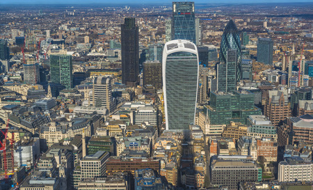 lloyds: LONDON UK - JANUARY 30, 2016: Panoramic aerial view of London with iconic modern skyscrapers including Gherkin, Walkie-Talkie, Tower 42, Lloyds bank which form business and banking area in London Editorial