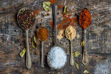 variability: Paprika and crystal salt on  rustic wooden background - closeup