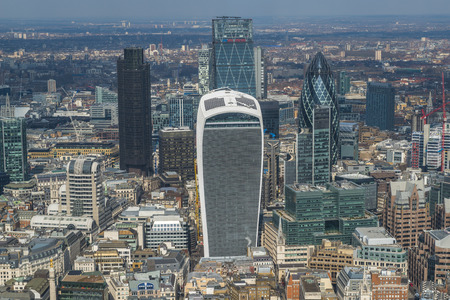lloyds: LONDON UK - MARCH 22, 2016: Panoramic aerial view of London with iconic modern skyscrapers including Gherkin, Walkie-Talkie, Tower 42, Lloyds bank which form business and banking area in London