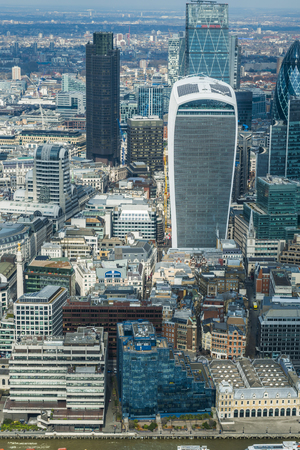 lloyd's of london: LONDON UK - MARCH 22, 2016: Panoramic aerial view of London with iconic modern skyscrapers including Gherkin, Walkie-Talkie, Tower 42, Lloyds bank which form business and banking area in London