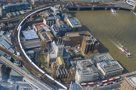 cross roads: LONDON UK - MARCH 22, 2016, 2016: Aerial view of London cityscape with roads, Charing Cross railway track and modern buildings