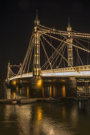 battersea: Illuminated Albert bridge in west London at night