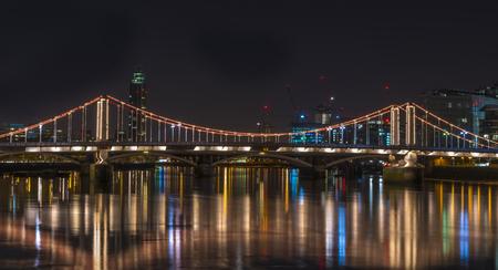 chelsea: Illuminated Chelsea Bridge at night, London, UK