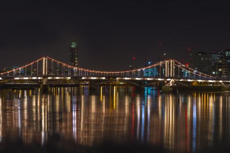 battersea: Illuminated Chelsea Bridge at night, London, UK