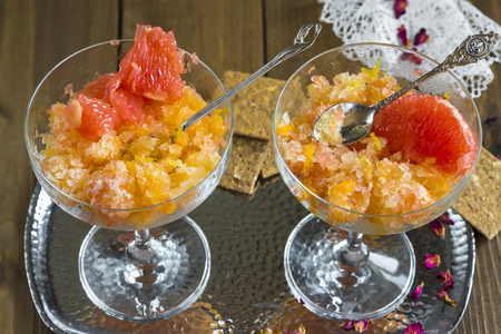 slush: Frozen pink grapefruit granita slush drink Foto de archivo