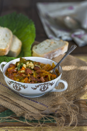 borlotti beans: Savoy cabbage stew with carrot and borlotti beans Stock Photo
