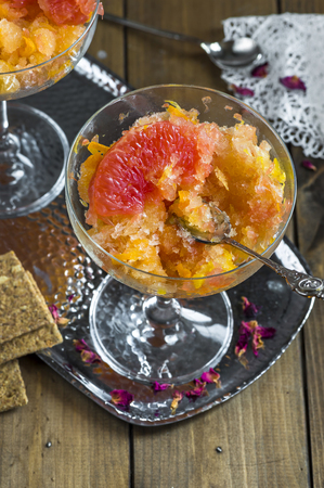 slush: Frozen pink grapefruit granita slush drink Stock Photo