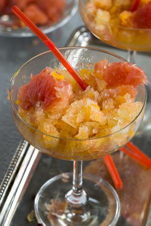 frozen drink: Frozen pink grapefruit granita slush drink Stock Photo