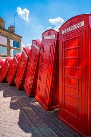 LONDON, UK - JULY 23, 2016: An art installation called Out of Order by David Mach in Kingston upon Thames. Its a series of 12 old red phoneboxes laid out as if they have fallen against each other.