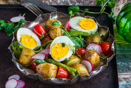 Summer potato and egg salad with vegetables Stock Photo